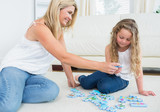 Daughter and mother doing a jigsaw