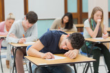 Man sleeping in exam hall