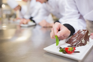 Chocolate cake being garnished