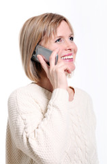 Caucasian middle aged woman on cellphone smiling