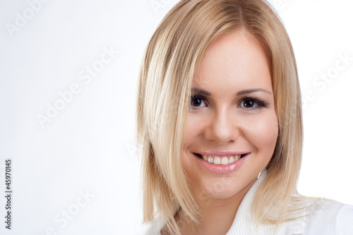 Spotless young blond woman smiles