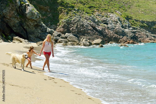 woman with child on beautiful beach