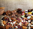 Chocolate nuts dried fruits and candy background