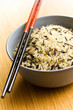 wild rice in ceramic bowl and chopsticks