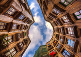 Looking up surrounded by old buildings in Barcelona. Spain.
