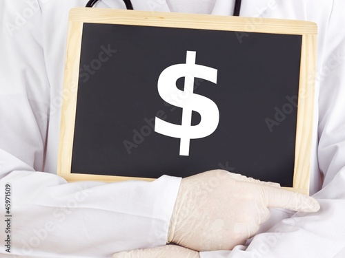 Doctor shows information on blackboard: dollar