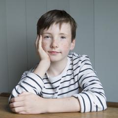 little boy in striped shirt