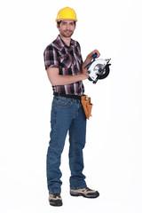 Worker holding circular saw