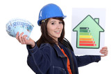 Tradeswoman holding up an energy efficiency and money