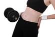 Slim girl lifting barbell