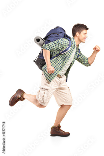 Hiker with backpack running
