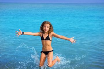 blue beach kid girl with bikini jumping and running