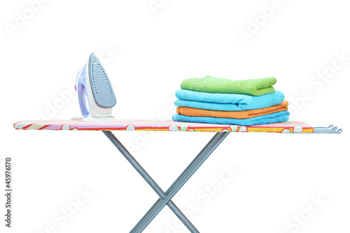 Studio shot of iron and towels on ironing board