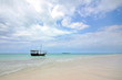 White Sandy beach with boat and Island with Blue Sky