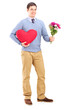Young man holding flowers and red heart