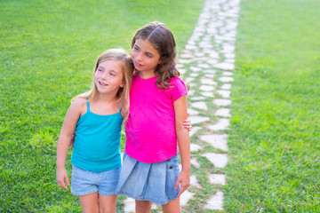 friends sister girls together in grass garden track