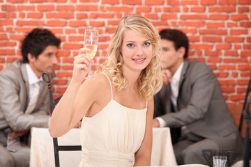 Blond woman with champagne in restaurant