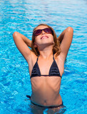 bikini kid girl with fashion sunglasses posing