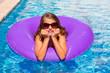 bikini girl with sunglasses and inflatable pool ring