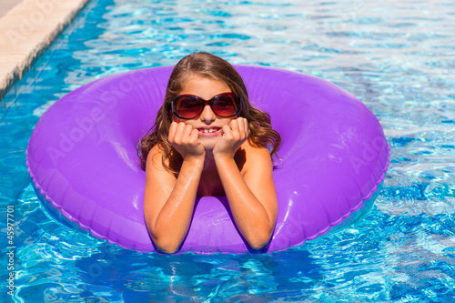 bikini girl with sunglasses and inflatable pool ring