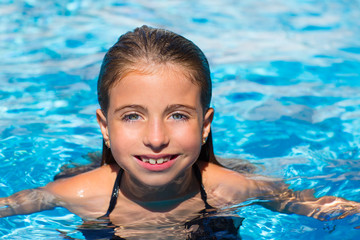 blue eyes kid girl at the pool face in water surface