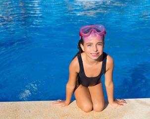 Blue eyes kid girl on knees on blue pool poolside
