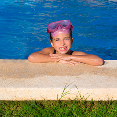 Blue eye kid girl on on blue pool poolside smiling