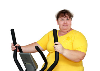 overweight woman exercising on trainer