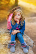 blond kid girl pensive bored in the forest outdoor