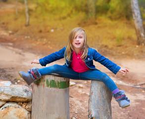 Open legs children girl or tree trunks at forest