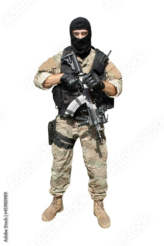 Special Forces soldier with an assault rifle isolated on white