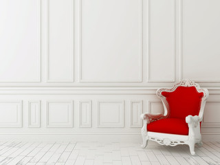 Red chair against a white wall