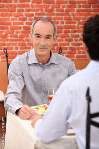 senior in a restaurant
