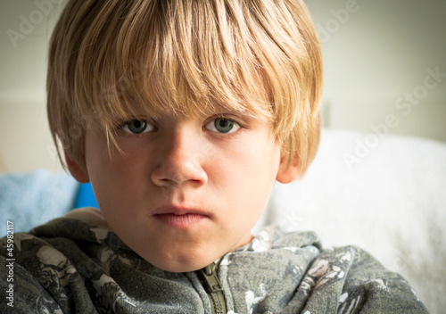 Upset boy with sad eyes
