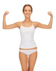 woman in cotton undrewear flexing her biceps