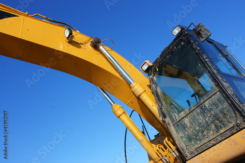 Hydraulic excavator against a blue sky