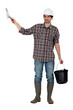 Builder with a trowel and a bucket