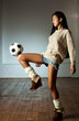 Young japanese woman playing football