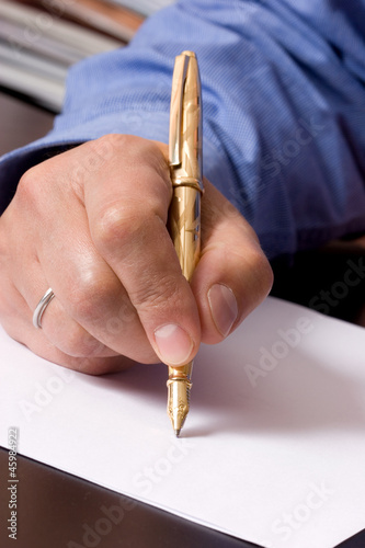 A man with a golden pen