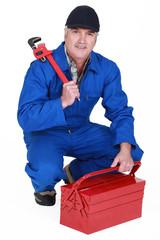 senior craftsman holding a spanner