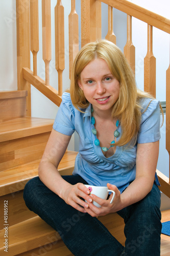 woman with cup of tea at the house