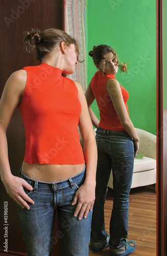 girl looking at a mirror