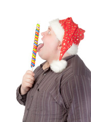 Cheerful fat man in Santa hat