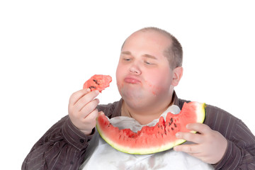 Fat man savouring a slice of watermelon