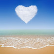 Heart shape of clouds with tropical beach background