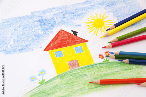 child drawing with pencils