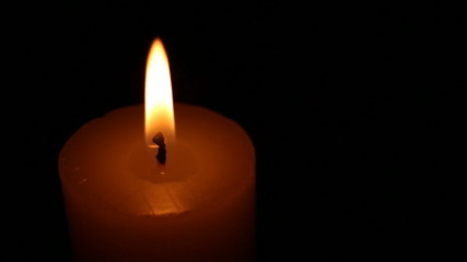 Agitated candle flame