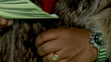 The hand of a rich man with a pack of dollars