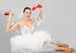 Portrait of smiling beautiful bride with  red shoes
