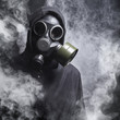 A man in a gas mask in the smoke